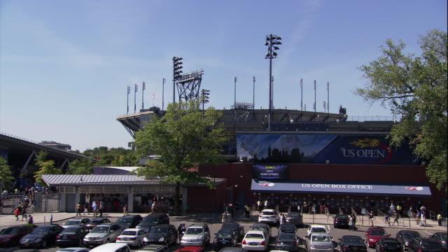 arthur ashe stadium and the grounds of the usta center - 英字点の映像素材/bロール