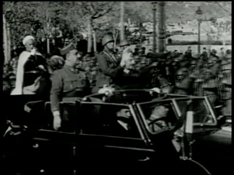 artillery firing generalissimo francisco franco standing in convertible car moving through street spanish moroccan soldiers calvary on horseback... - spain stock videos & royalty-free footage