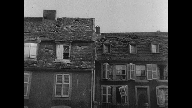 MONTAGE Artillery shells falling among buildings, soldiers under cover, destruction in town, and the wreckage of blown bridges / Strasbourg, France