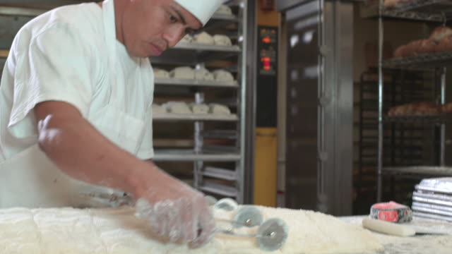 artisanal bakery - commercial kitchen stock videos & royalty-free footage