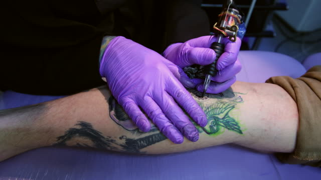 artist and tattooist dan gold creates a tattoo featuring an image of albert einstein in his west hampstead studio on april 22 2014 in london england... - machinery stock videos & royalty-free footage