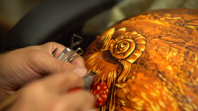 artist carving into pumpkin - carving food stock videos and b-roll footage