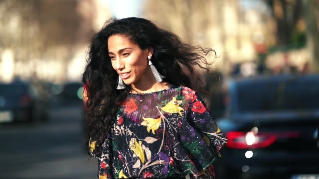 artist ciinderella b wears a multicolor pleated lace floral print dress a chloe bag earrings orange shoes outside dior during paris fashion week... - chloe designer label stock videos and b-roll footage