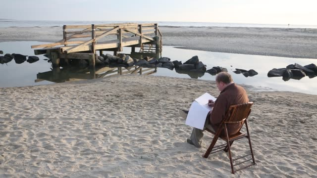 artist drawing landscape at the beach - pencil drawing stock videos & royalty-free footage