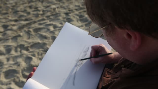 artist drawing landscape at the beach - only mature men stock videos & royalty-free footage