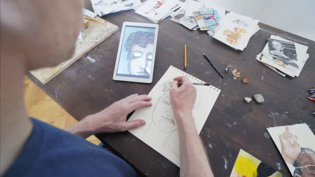 Artist drawing using a digital tablet.