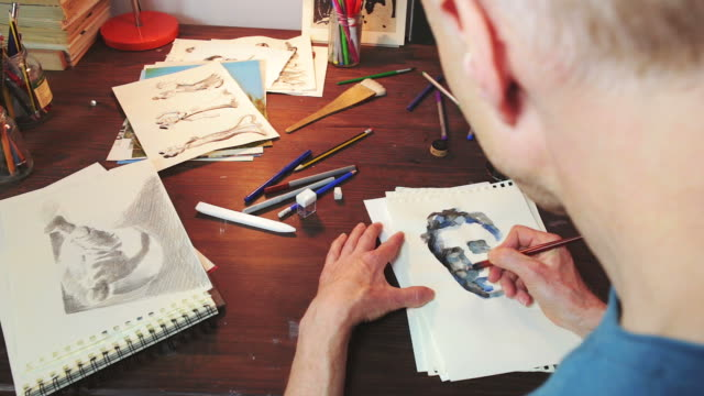 artist drawing using ink method. - human face drawing stock videos & royalty-free footage