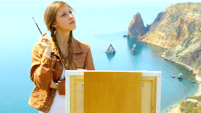 artist draws on the beautiful wild coast - fine art portrait stock videos & royalty-free footage