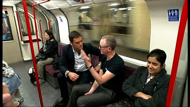 artist hunts for stories of kind acts on the london underground; england: london: int low angle view of london underground train into station crowd... - chance stock videos & royalty-free footage