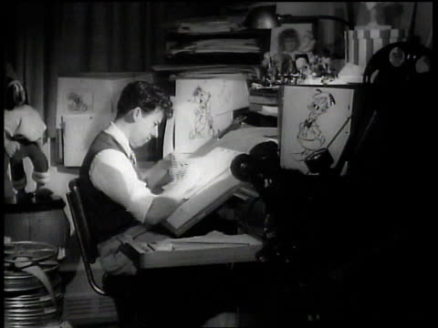 vídeos de stock, filmes e b-roll de 1943 ms artist inking, drawing and flipping through cels at walt disney animation studios / hollywood, california, united states - 1943