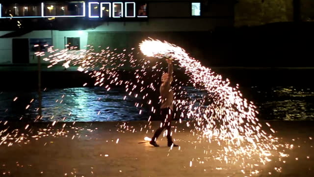artist juggling with two burning poi's at fire performance. - performance stock videos & royalty-free footage
