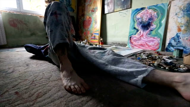 artist lying down in studio - atelier tent stock videos and b-roll footage