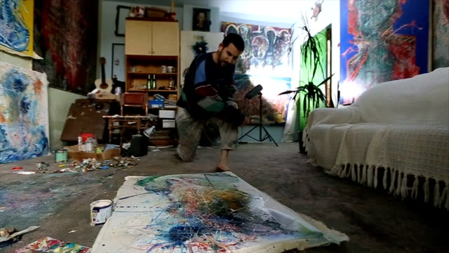 artist man painting - professional painter stock videos and b-roll footage