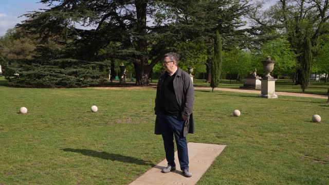 """artist mark wallinger stands amongst his artwork 'british summer time' on the grounds of chiswick house and gardens during the """"bring into being""""... - standing stock videos & royalty-free footage"""