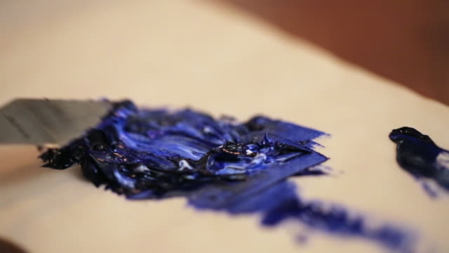 artist mixes paint with knife - paint tube stock videos and b-roll footage
