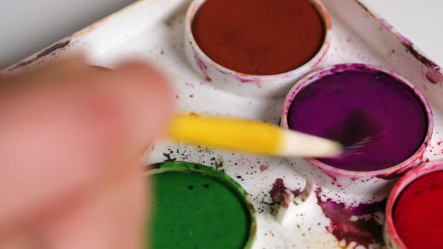 artist mixes watercolour paints - magenta stock videos & royalty-free footage