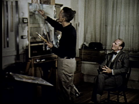 artist norman rockwell painting in studio, man watching sitting on chair - paintbrush stock videos & royalty-free footage