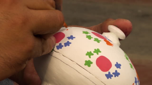 vídeos y material grabado en eventos de stock de artist painting a paper mache powder box - papier