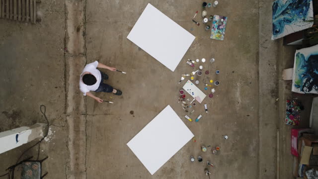 artist painting on street - canvas stock videos & royalty-free footage