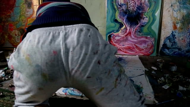 artist painting on the floor - atelier tent stock videos and b-roll footage