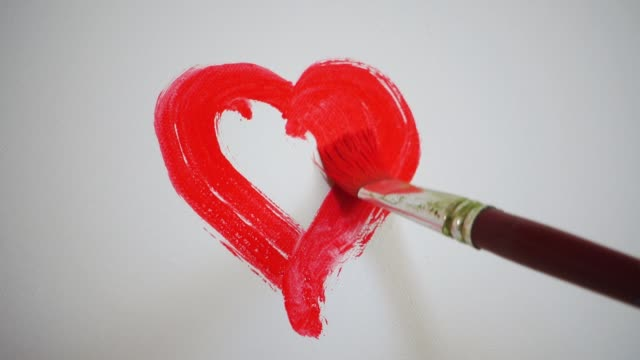 artist paints heart on canvas - canvas stock videos & royalty-free footage
