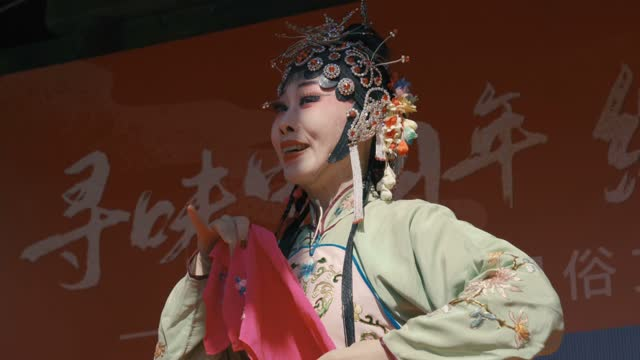 artist performing qin opera in chinese spring festival temple fair on february 16 in xi'an, shaanxi province of china. - young women stock videos & royalty-free footage