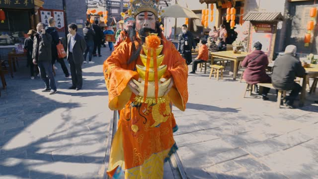 artist performing shehuo in spring festival temple fair on february 16 in xi'an, shaanxi province of china. - cultures stock videos & royalty-free footage