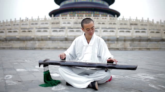 MS Artist playing the Guqin in Temple of Heaven in Beijing, China