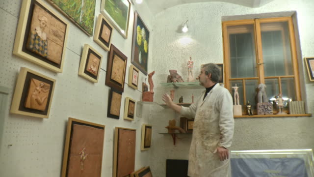 HD DOLLY: Artist Proudly Looking His Gallery