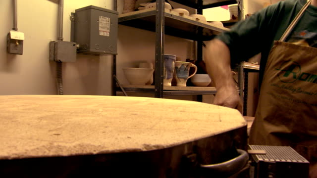 artist putting finished pieces of clay into a kiln - kiln stock videos and b-roll footage