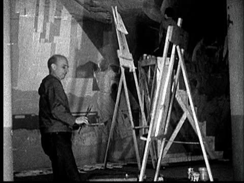 1935 film montage ms artist rockwell kent painting on easel/ audio - artist stock videos & royalty-free footage