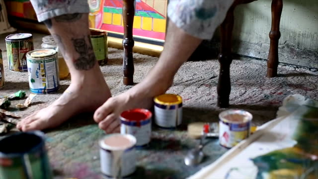 artist sitting on chair - atelier tent stock videos and b-roll footage