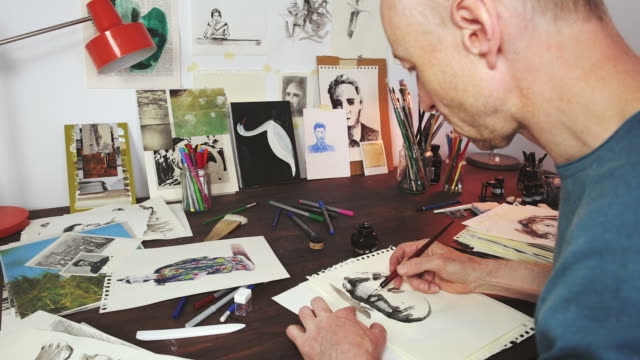 artist working in his workshop. - illustrator stock videos & royalty-free footage