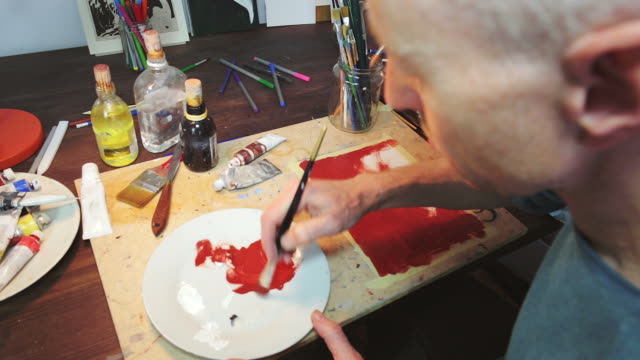 artist working in the studio. - painter artist stock videos and b-roll footage