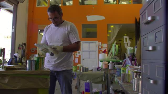 MS Artist working in workshop, Malibu, California, USA