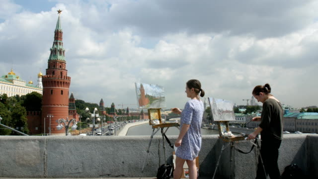 Artist working with water colours , painting the Kremlin/ view from Moscow River/ Moscow, Russia