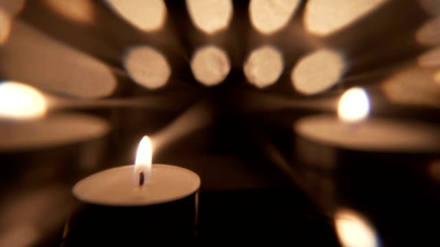 artistic candle motion background - tea light stock videos and b-roll footage