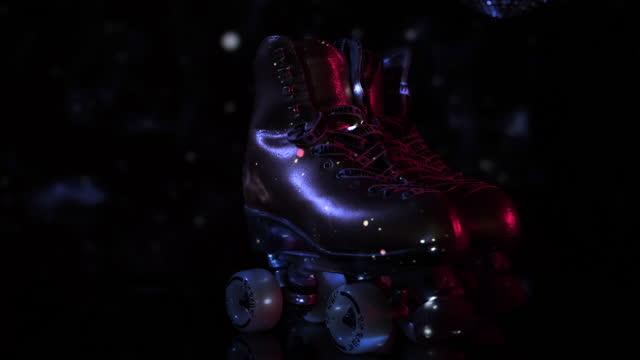 artistic golden roller skates in disco light. - disco dancing stock videos & royalty-free footage
