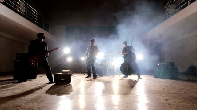 artistic troupe playing punk rock on theater stage - punk music stock videos and b-roll footage