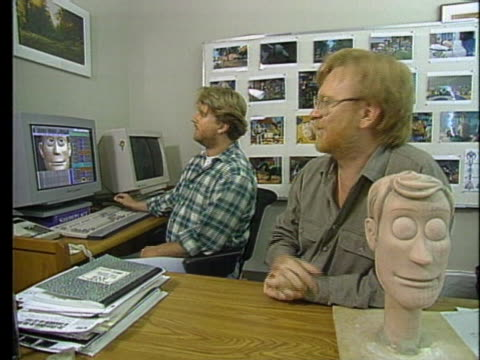 artists and computer programmers work together to make the movie toy story. - artist stock videos & royalty-free footage