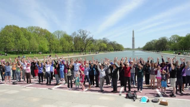 artists at washingtons lincoln memorial sunday to take part in a flash mob performance in protest against gun violence clean an art flash mob against... - flash mob stock videos and b-roll footage