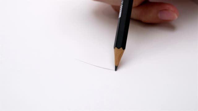 artists hands drawing wooden pencil writes on paper shot - note pad stock videos & royalty-free footage