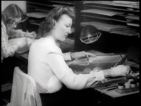 vídeos de stock, filmes e b-roll de 1943 ms artists inking and drawing at walt disney animation studios / hollywood, california, united states - walt disney animation studios