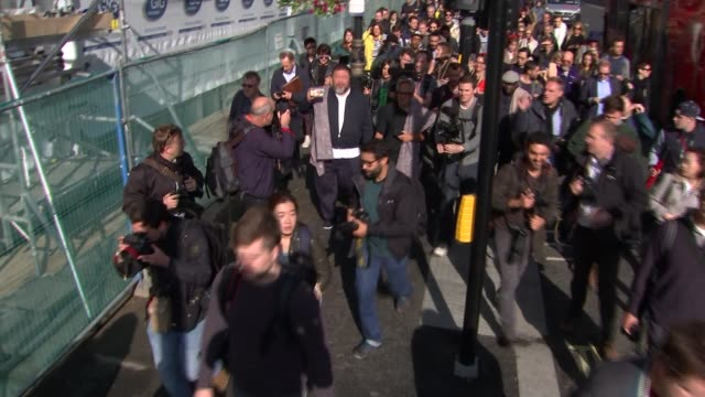 Artists lead walk across London to highlight plight of refugees ENGLAND London Piccadilly Circus EXT Artists Anish Kapoor and Ai Weiwei leading group...