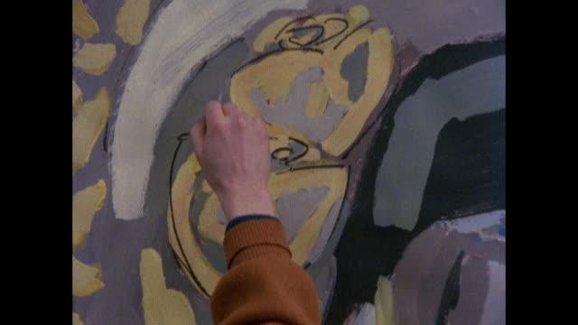 MONTAGE Artist's painting in studio