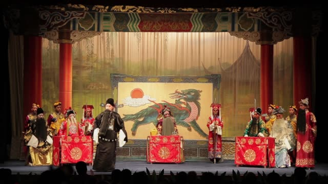 Artists perform a local Chinese traditional Qinqiang opera on stage.