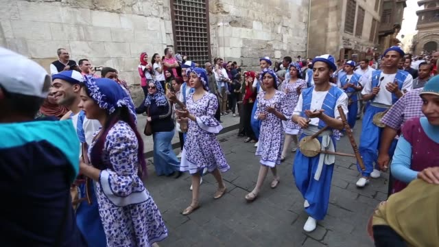 artists perform with drums as they march at the opening ceremony of the 5th international festival for drums and traditional arts in el moez street... - drummer stock videos & royalty-free footage