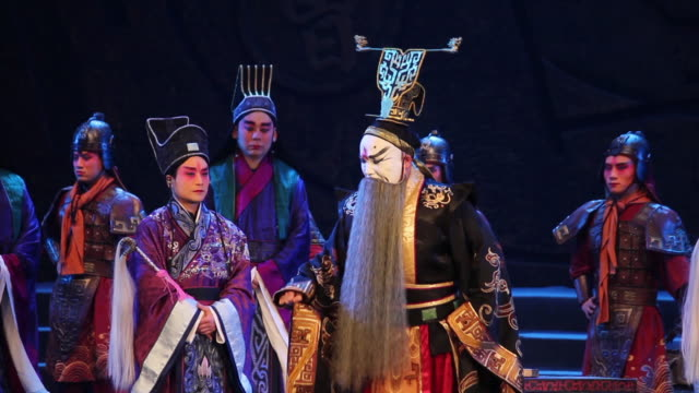 ms artists performing local chinese traditional qinqiang opera on stage audio / xi'an, shaanxi, china - hand an der hüfte stock-videos und b-roll-filmmaterial