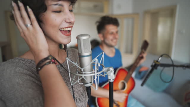 artists recording a new song in home studio - producer stock videos & royalty-free footage