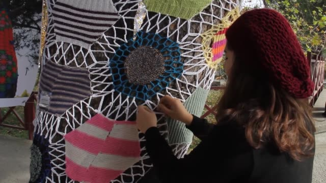 Artists take part in a tree knitting event in Bursa province of northwestern Turkey on November 13 2017